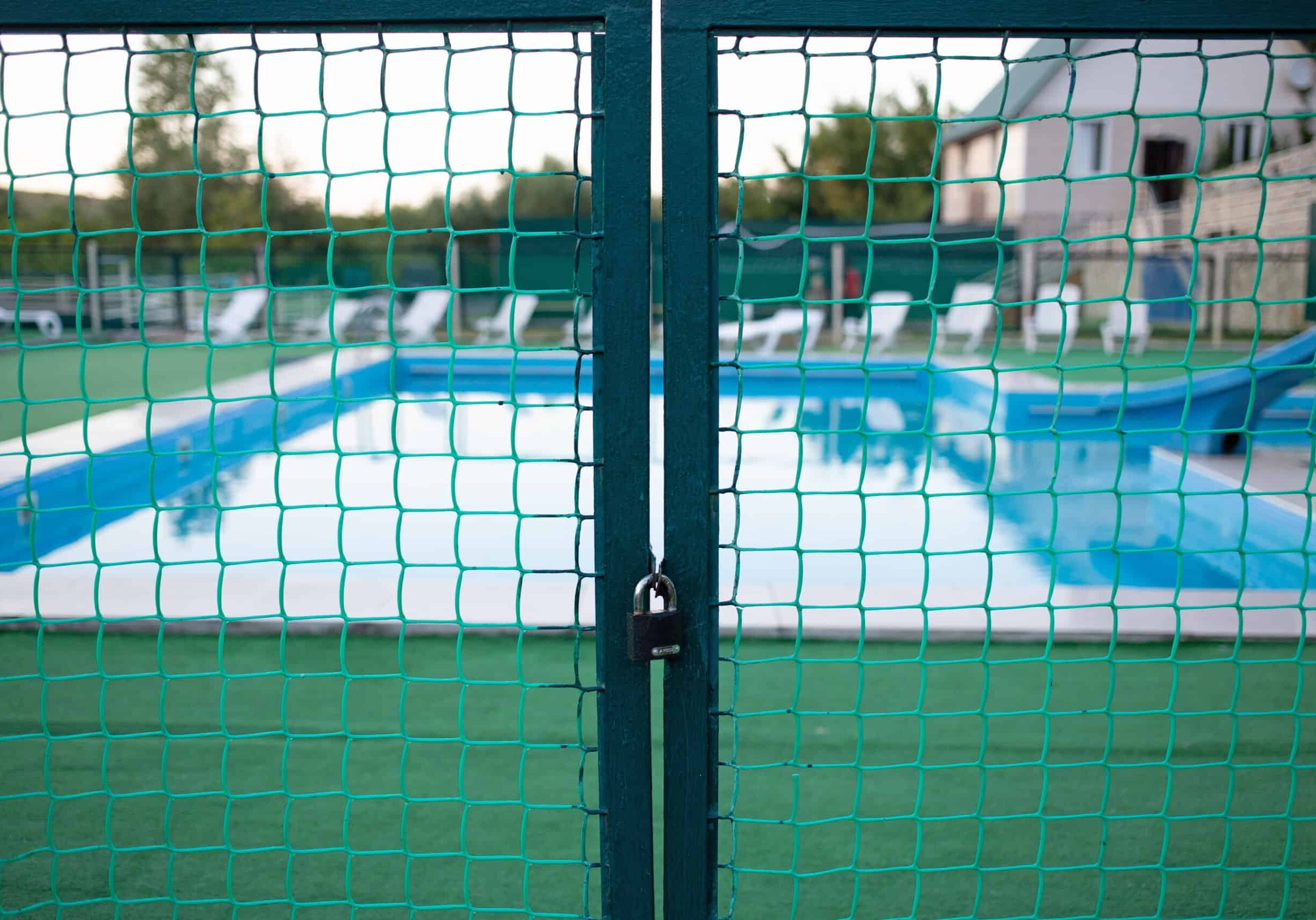 A closed gate at the entrance to the pool